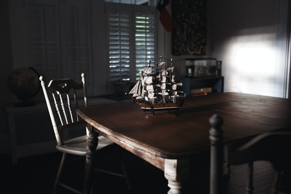 ship miniature on table
