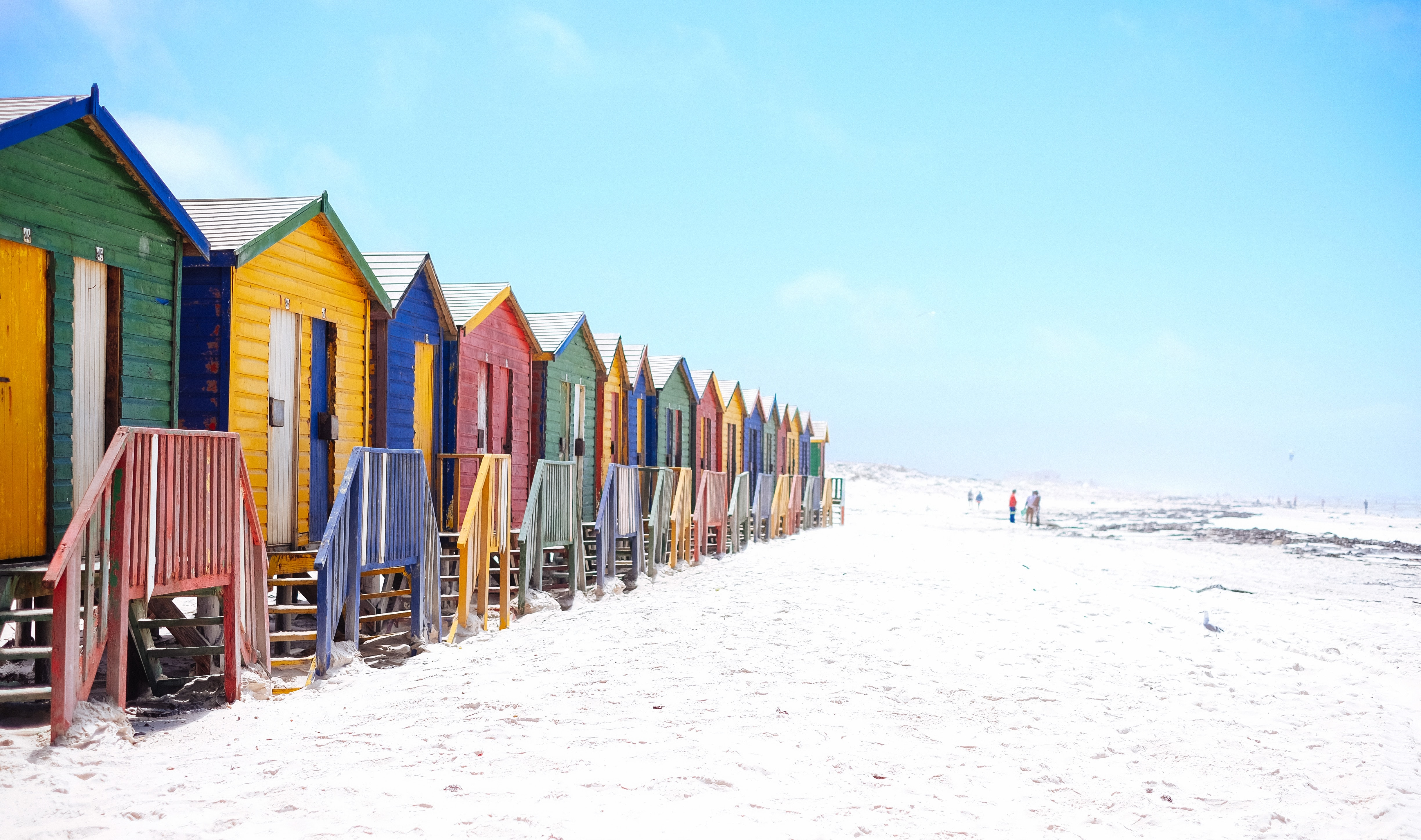 Colorful beach huts on a white sand beach in Muizenberg