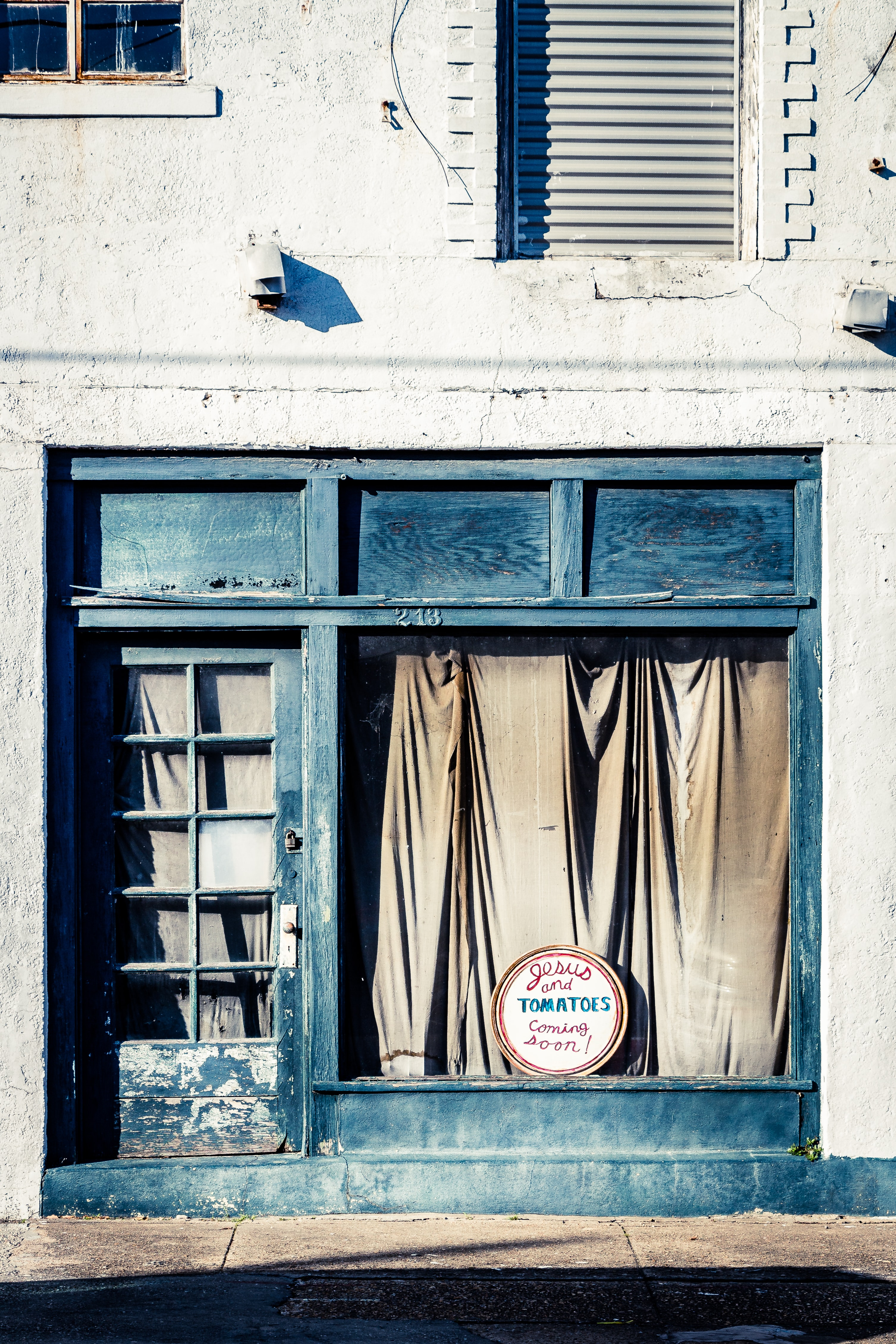 photo of closed store with black door