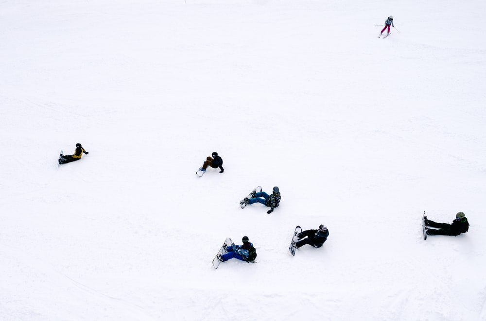 people playing snowboards