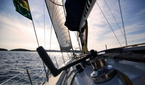 Deck of Sailboat undersail listing port. Get an Insurance Quote for your boat or jetski. - www.The-MillerInsuranceAgency.com.