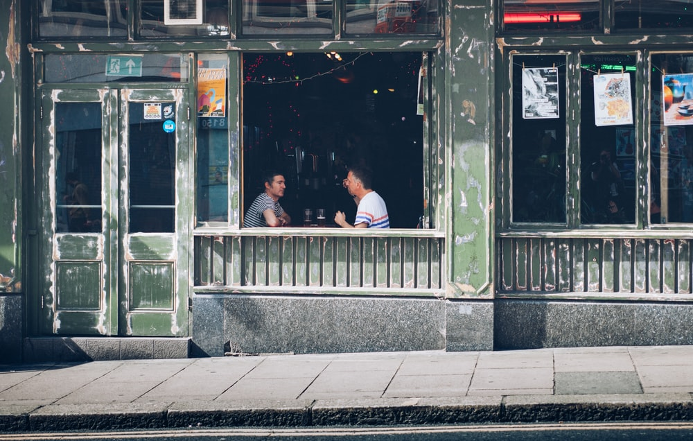 two person talking inside the bar during daytime