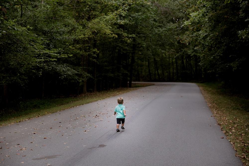 children sitting on road