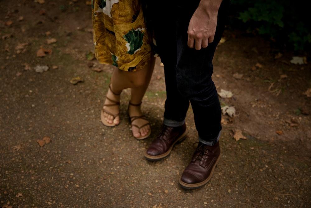 man standing beside woman