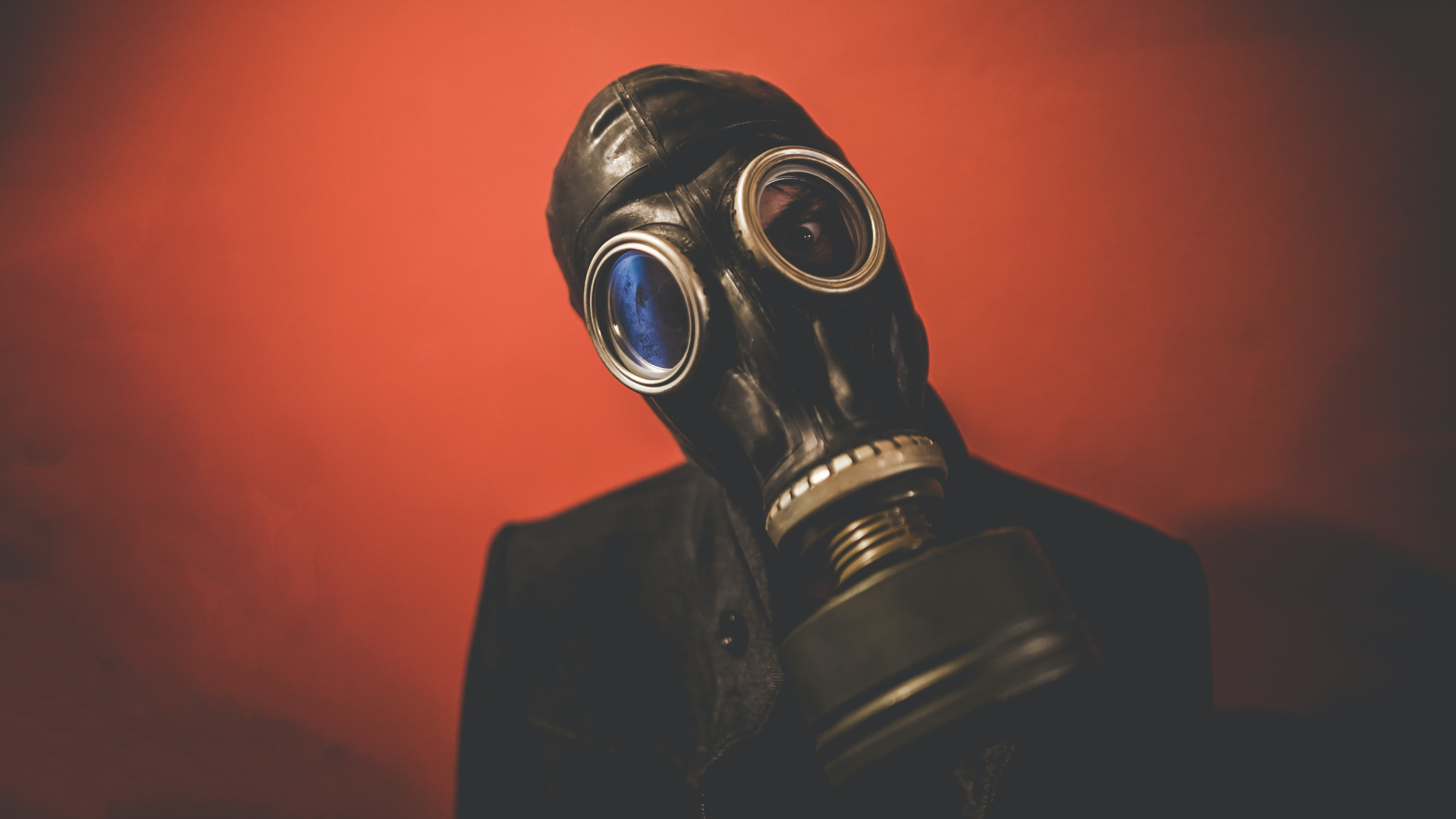 A person wearing a gas mask helmet.