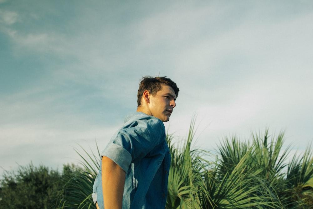 man wearing blue chambray top