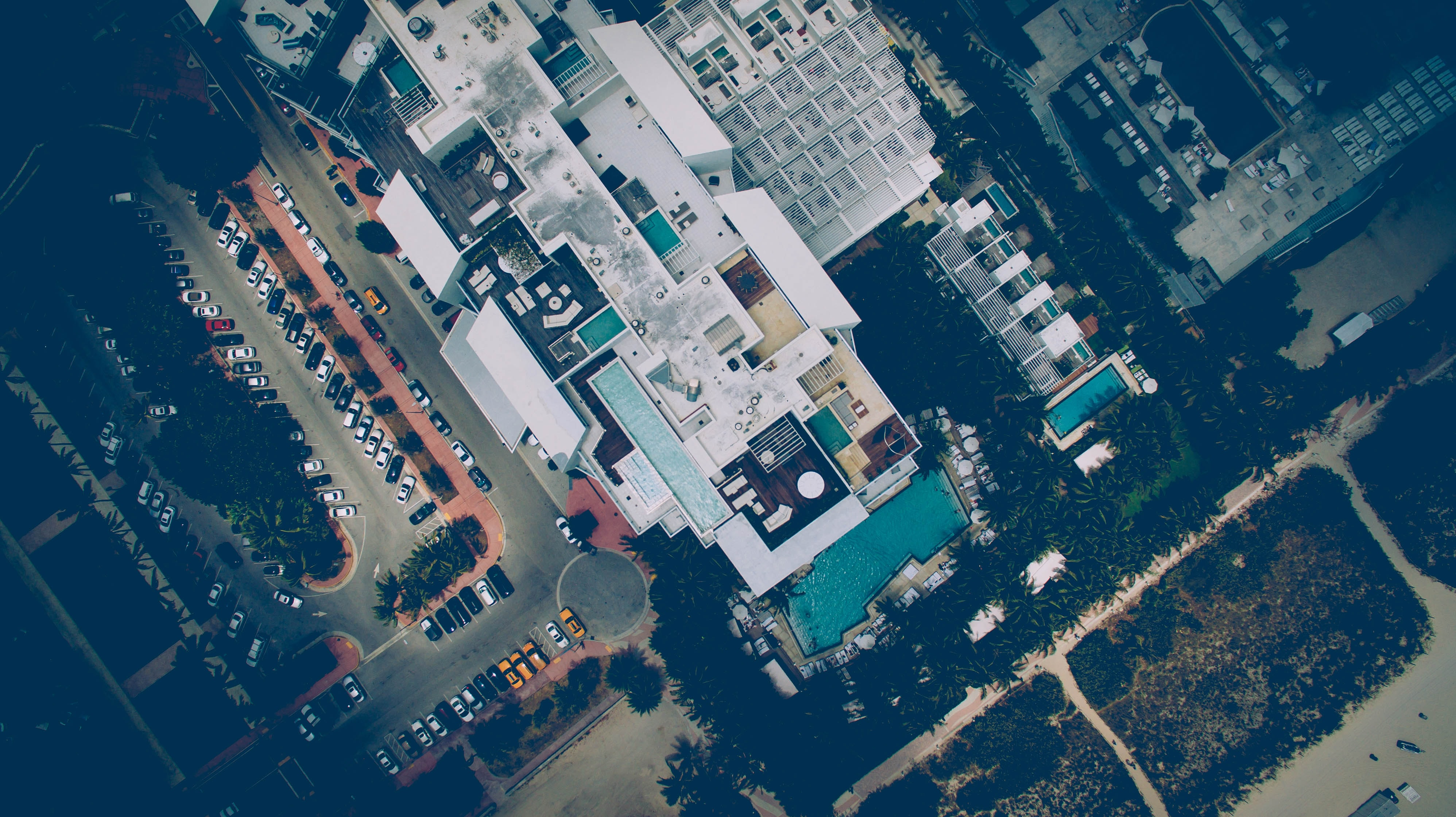Drone aerial view on a hotel terraces with rooftop pools in Miami Beach