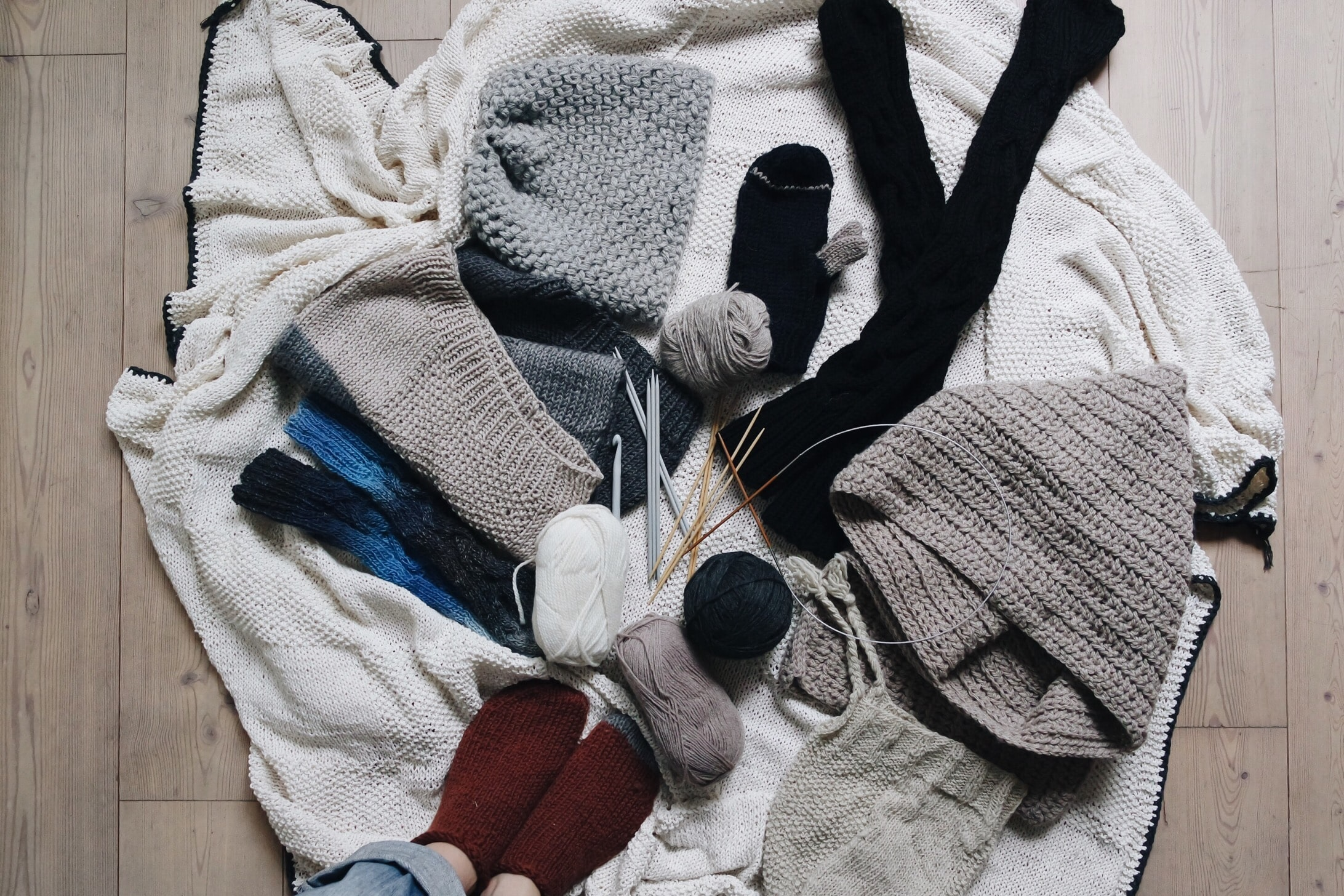 Knit socks, blankets, sweaters, and knitting needles in Milan