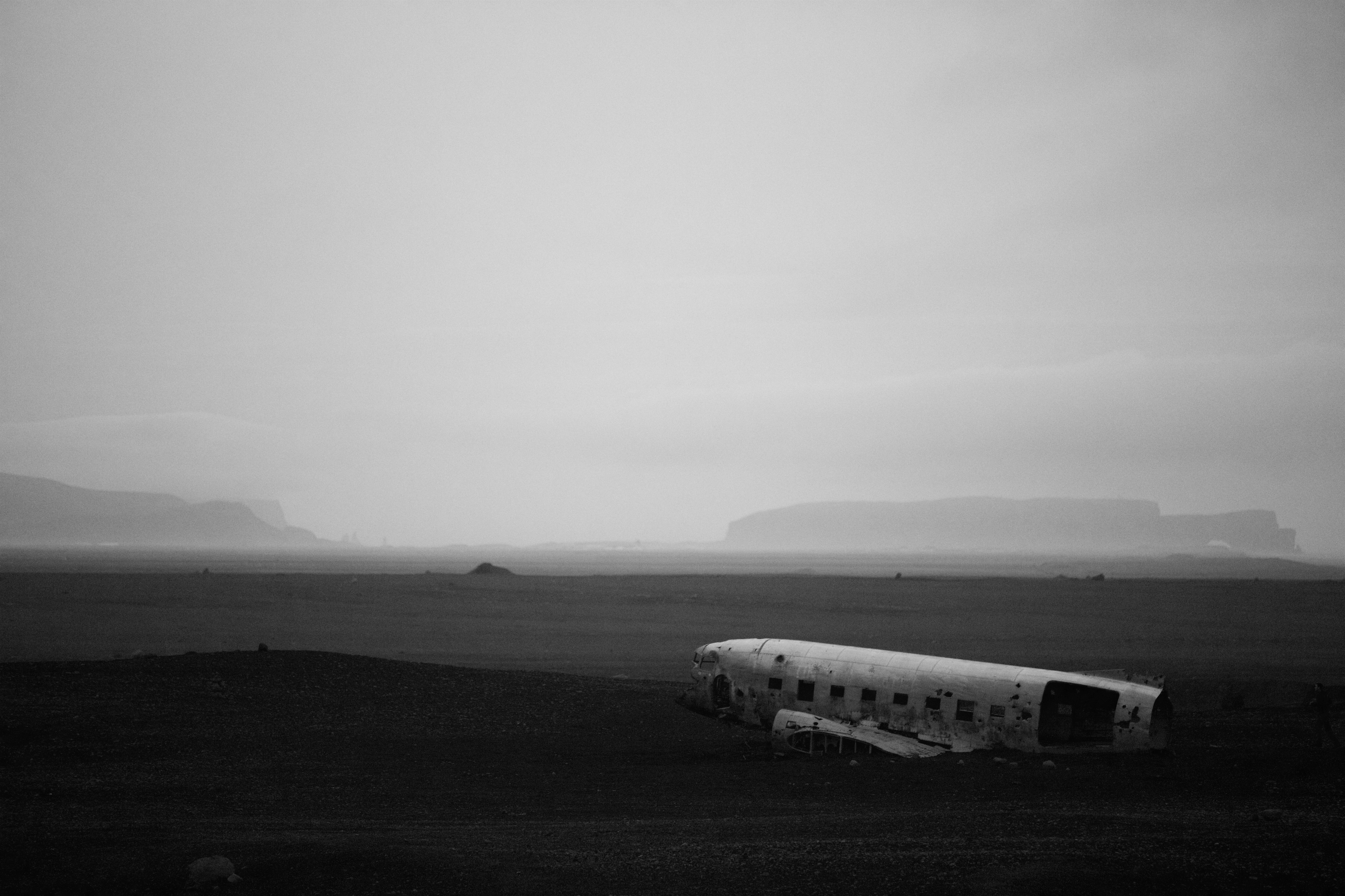Black and white shot of plane wreck with clear sky and mist, Solheimasandur Plane Wreck