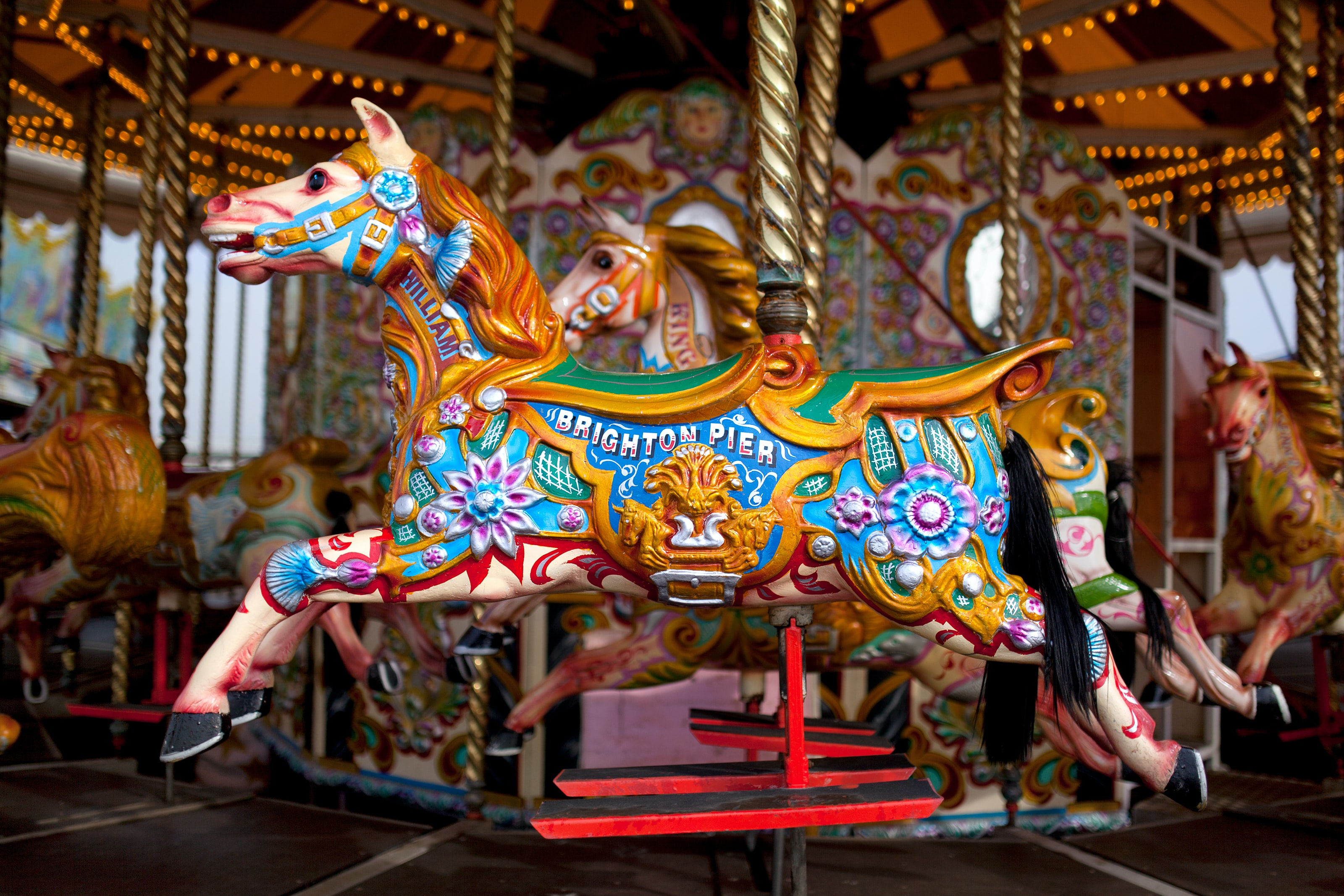 A colorful wooden horse in a merry-go-round in Brighton