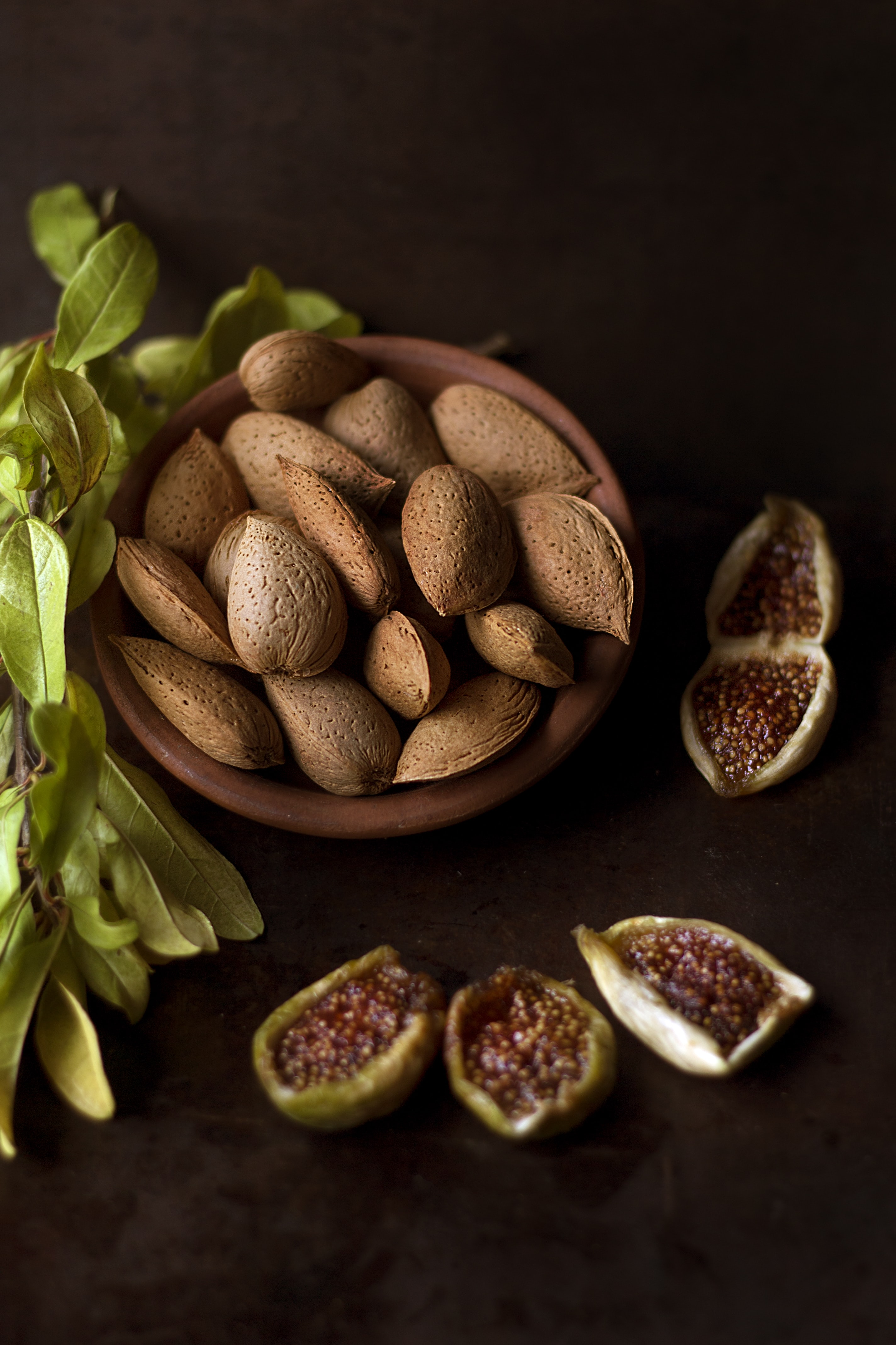 Bowl of almonds by figs and fennel