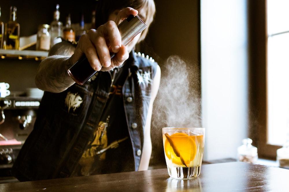 bartender holding spray bottle