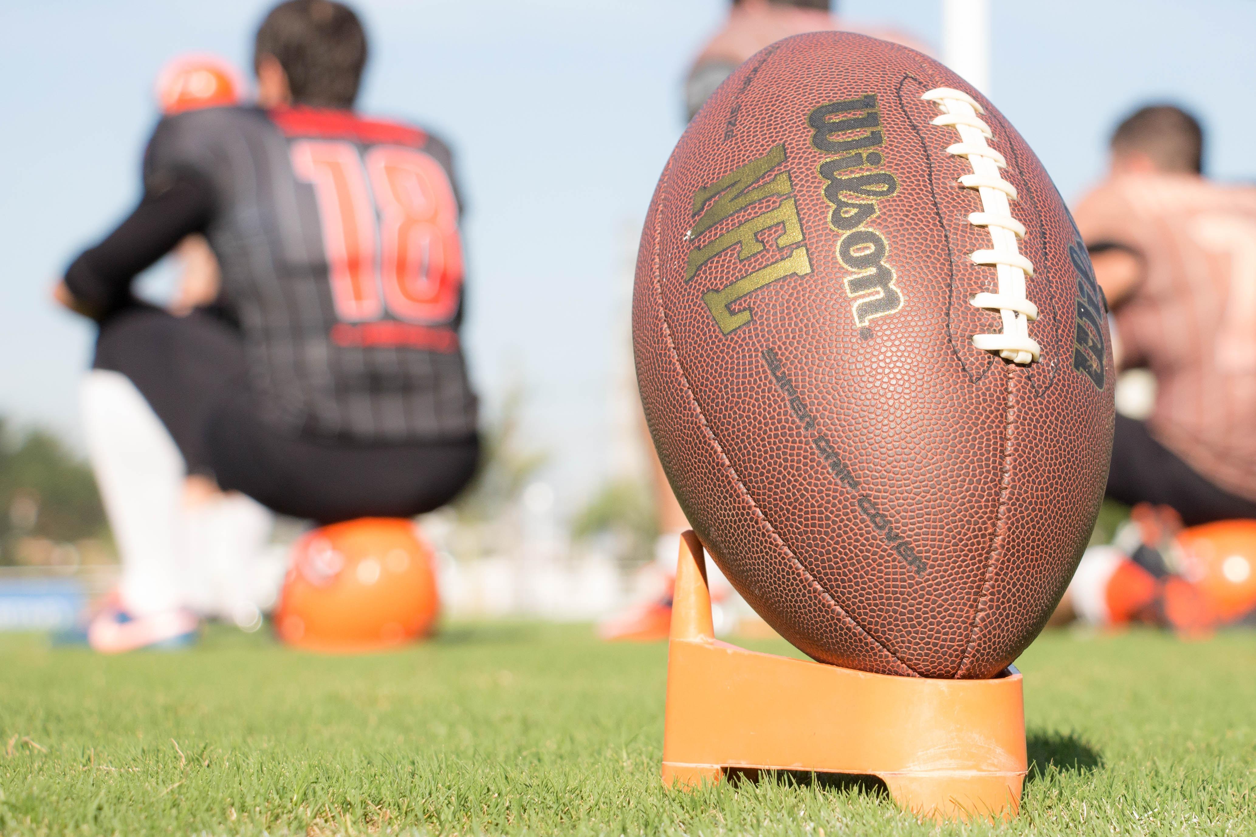 Macro view of a Wilson NFL football ball with a stand at the Pontifícia Universidade Católica do the Rio Grande do Sul