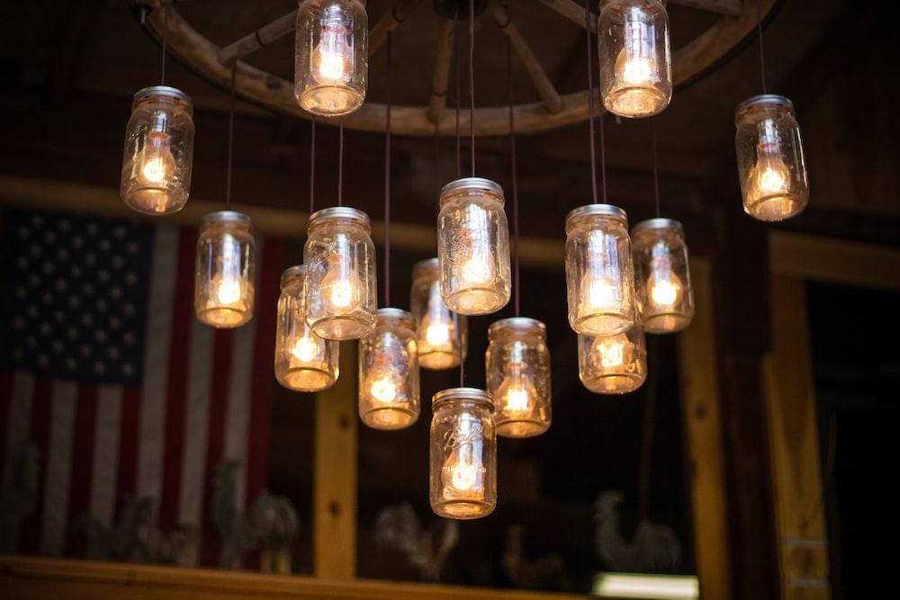 clear glass mason jar hanging lamp turned on