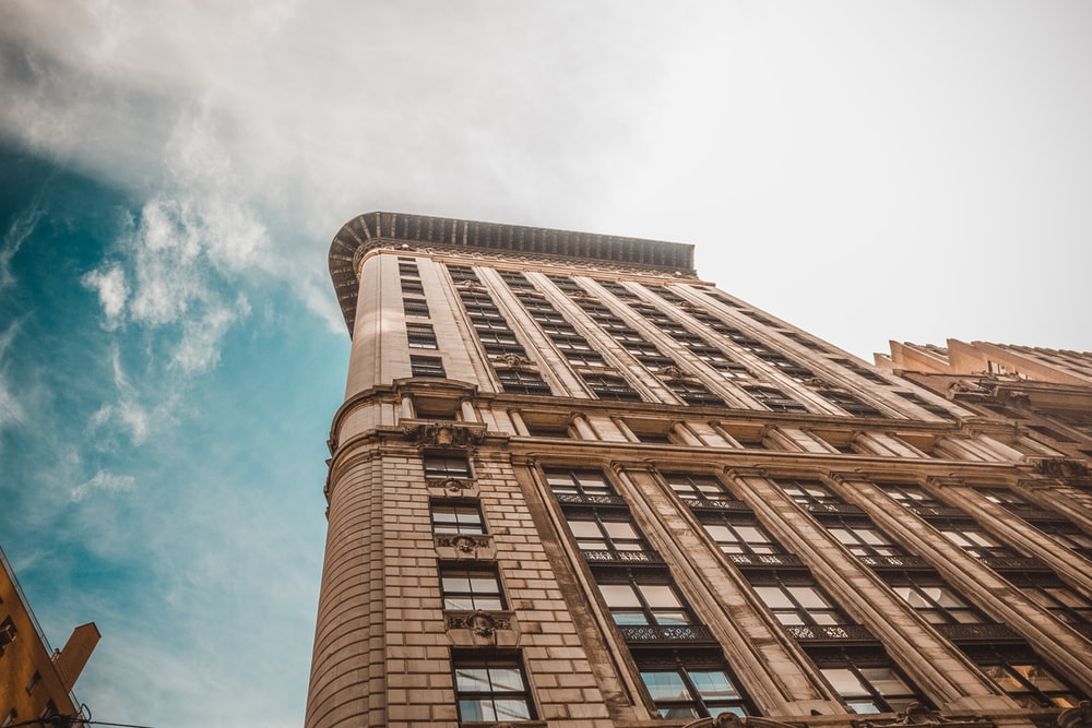 worm's eye view photography of brown building