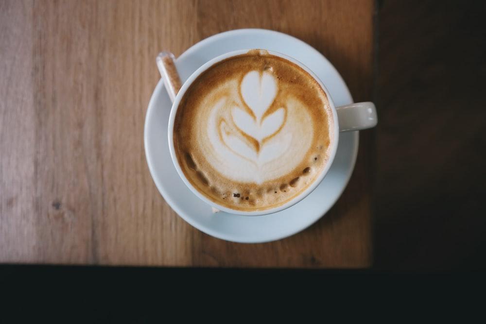 white ceramic cup with espresso coffee