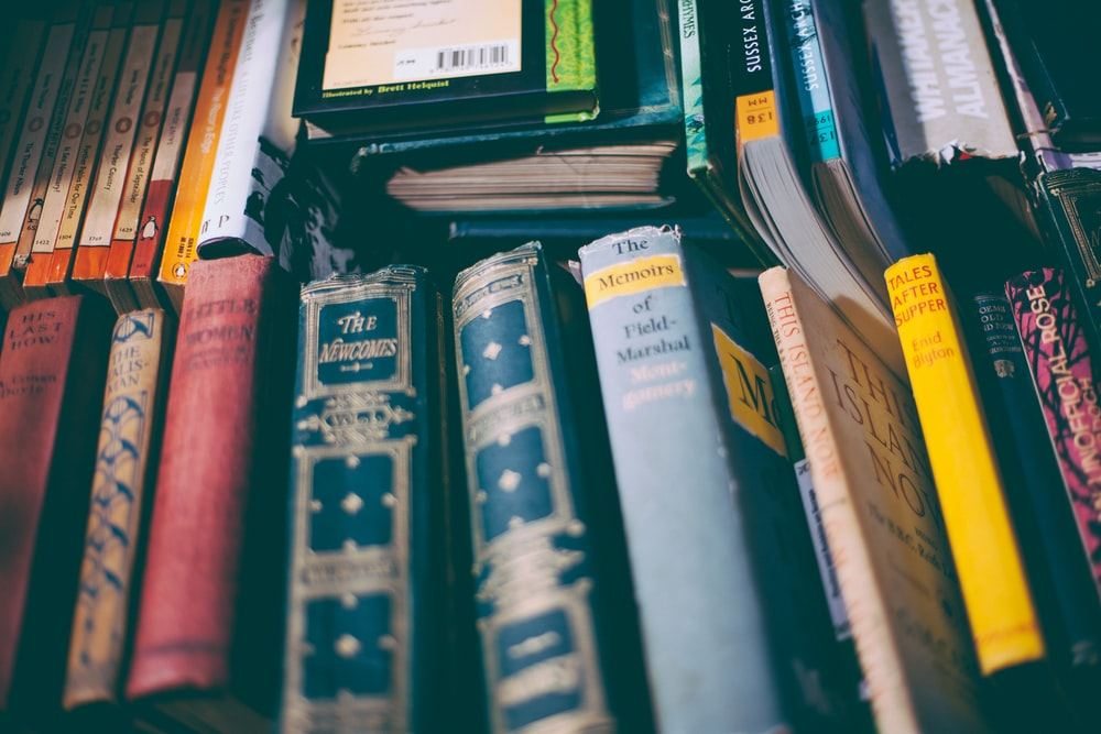 Collection of old books photo by Thomas Kelley (@thkelley) on Unsplash