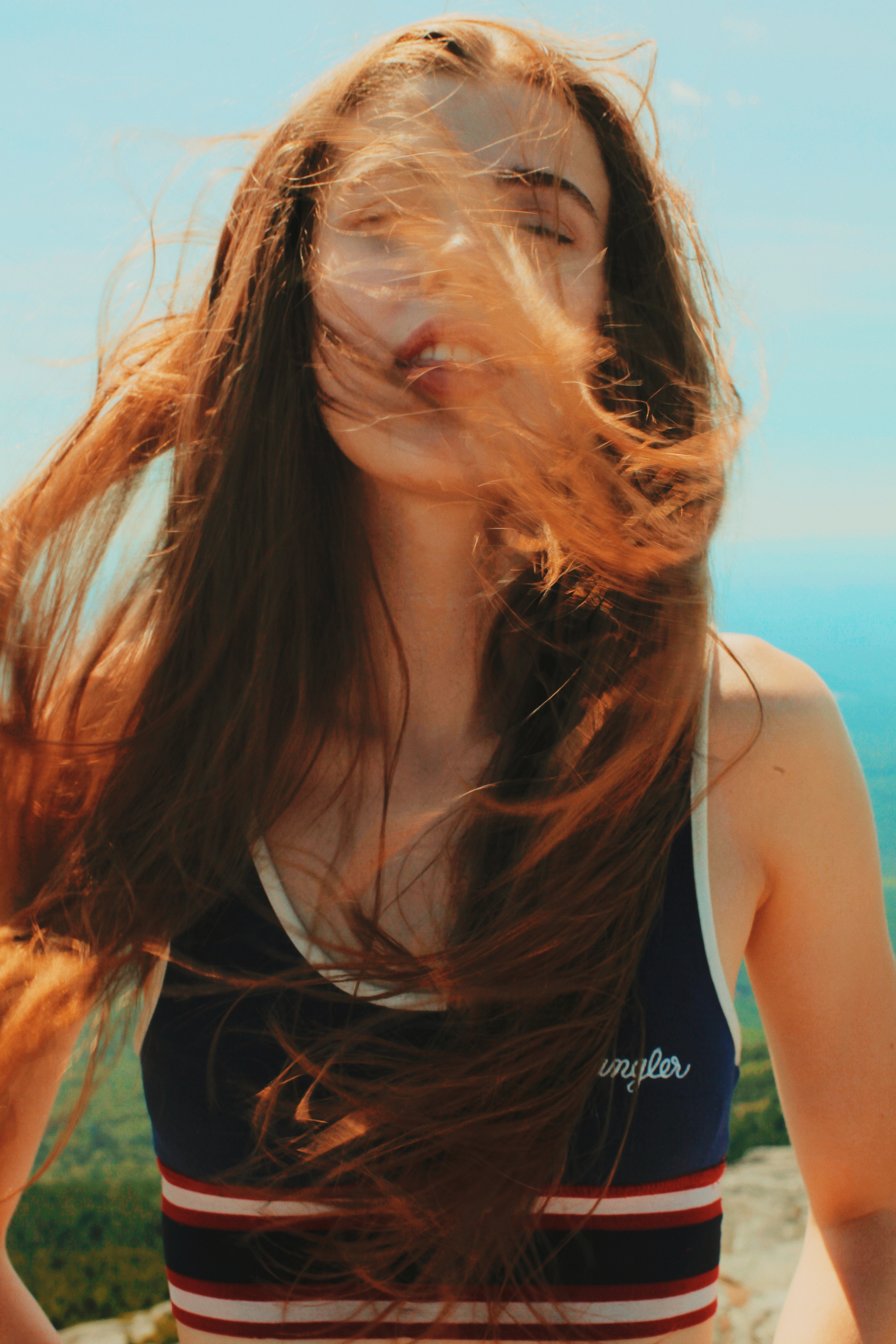 photo of woman wiping her hair