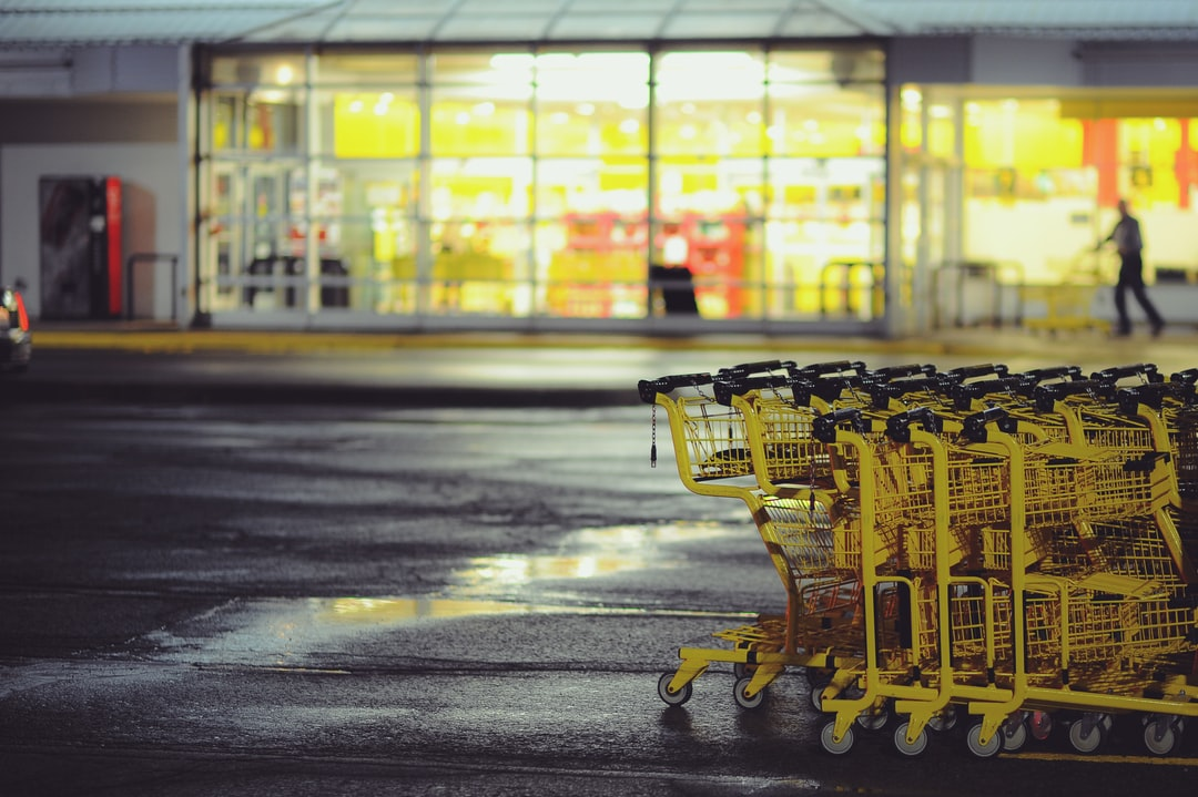 Yellow shopping carts stacked on a parking lot