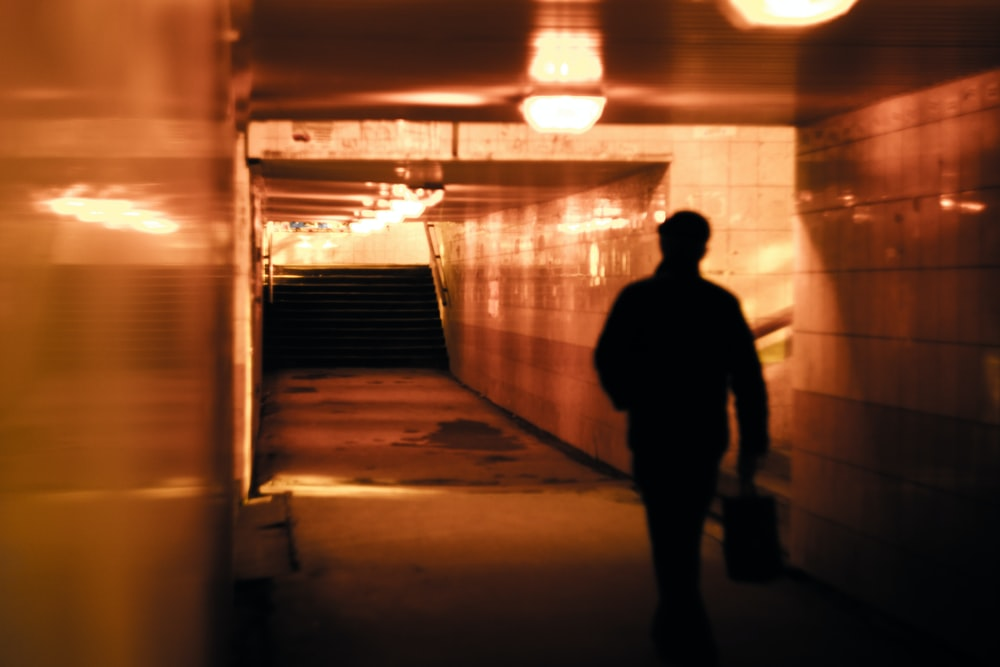 man walking inside building with stair