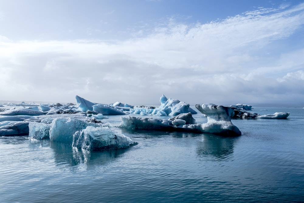 photo of ice bergs during daytime