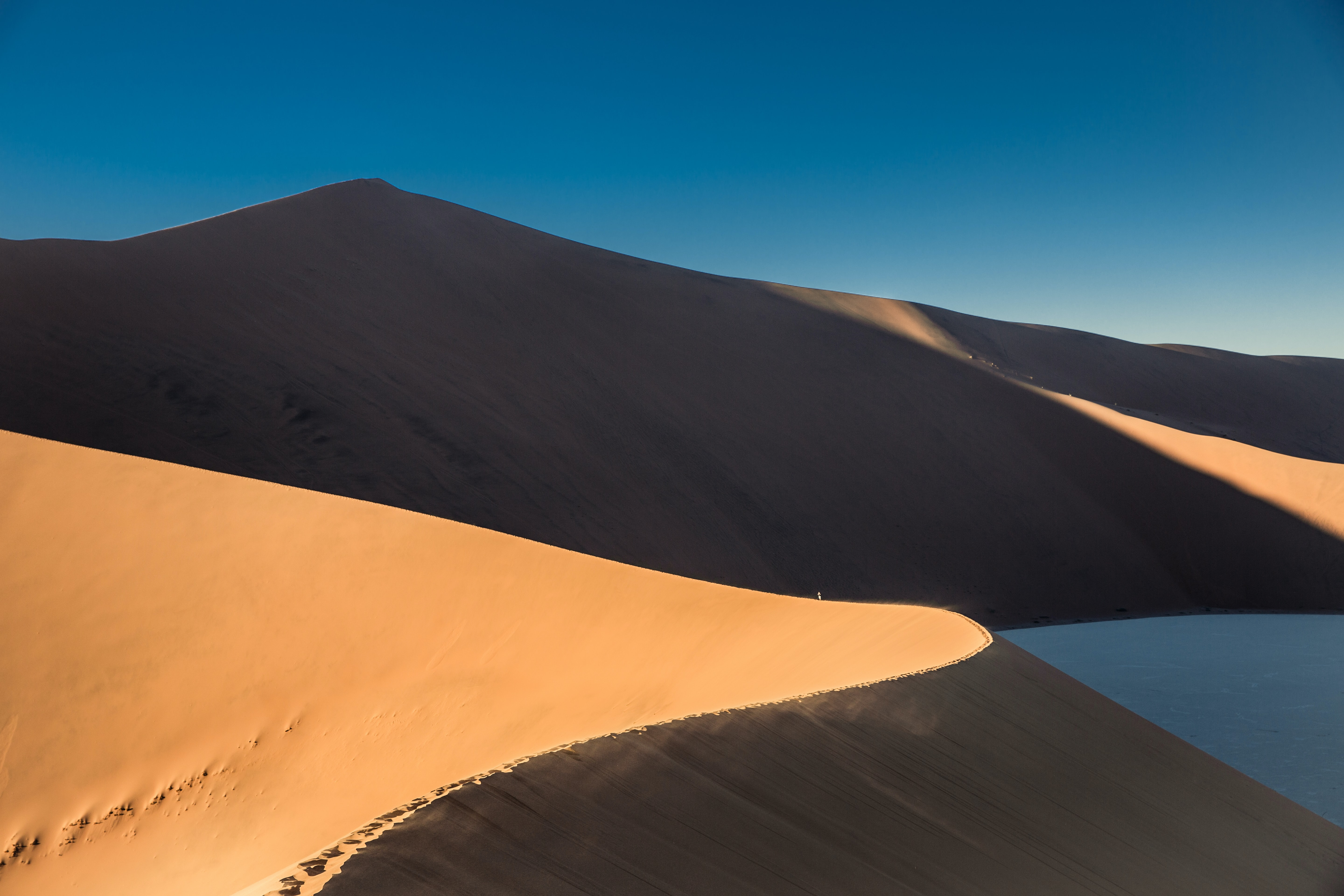 Sand dunes and ridges in the desert at sundown