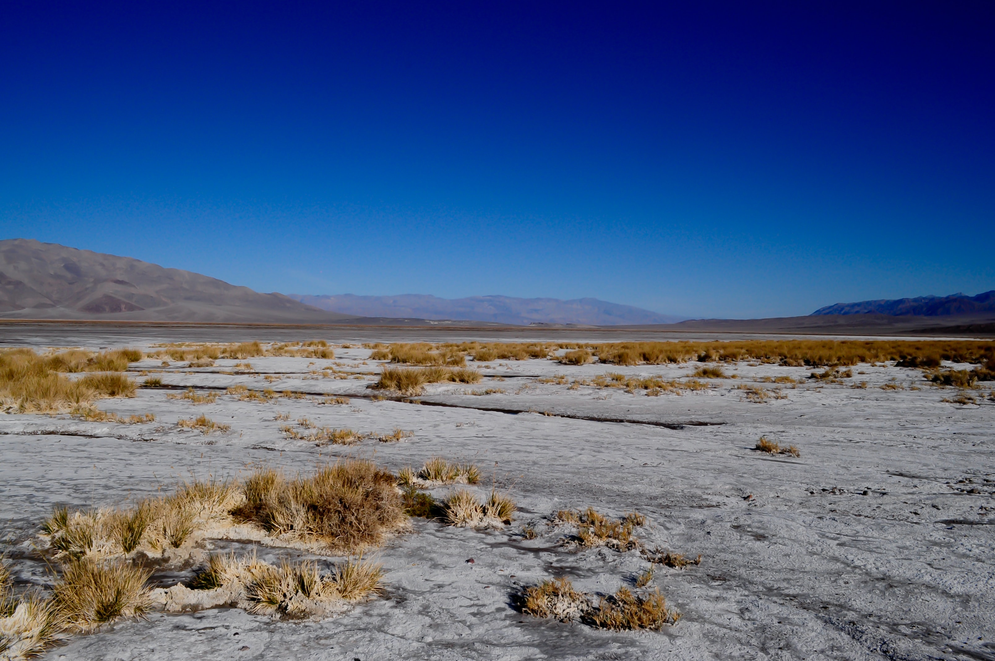 Desolate desert terrain and blue sky in Death Valley