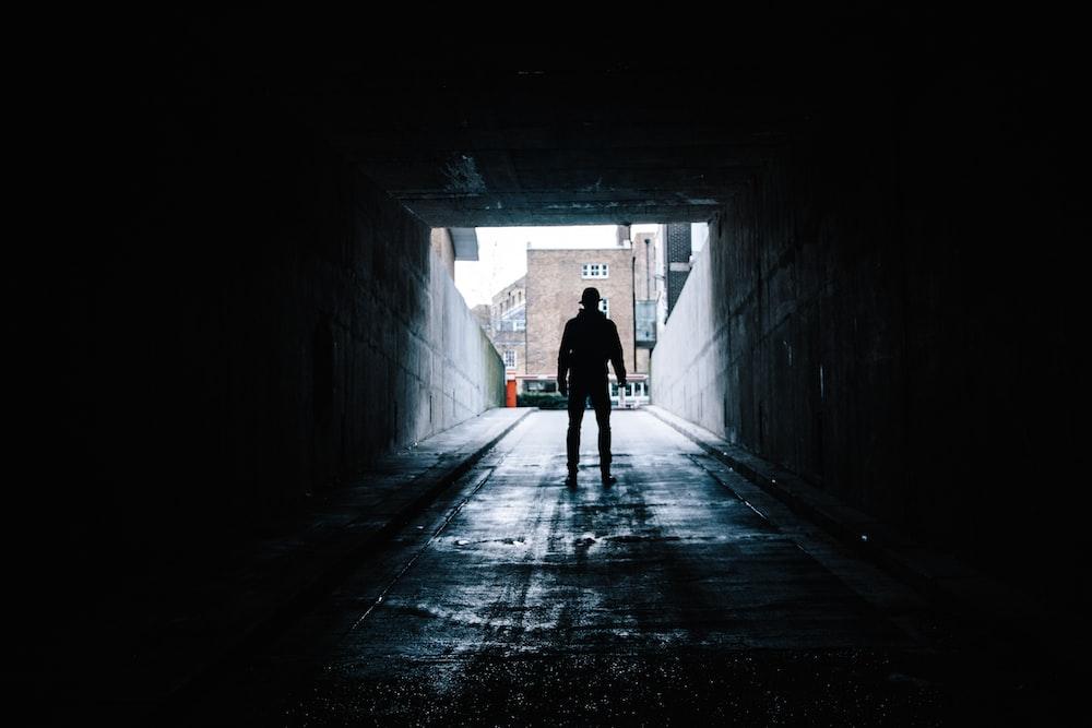 silhouette of man in underground garage