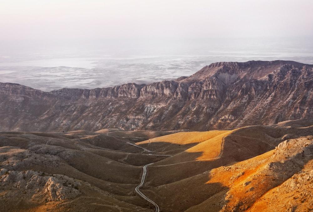road in between of mountain