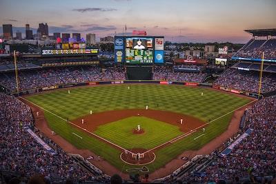 players and fans on baseball stadium baseball teams background