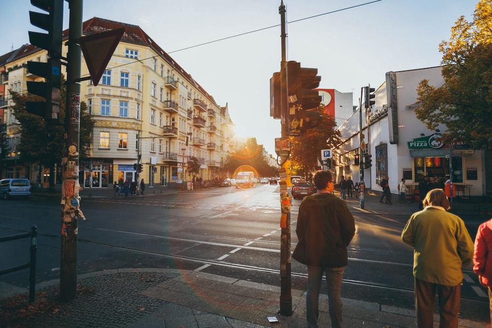 men walking near concrete buildings