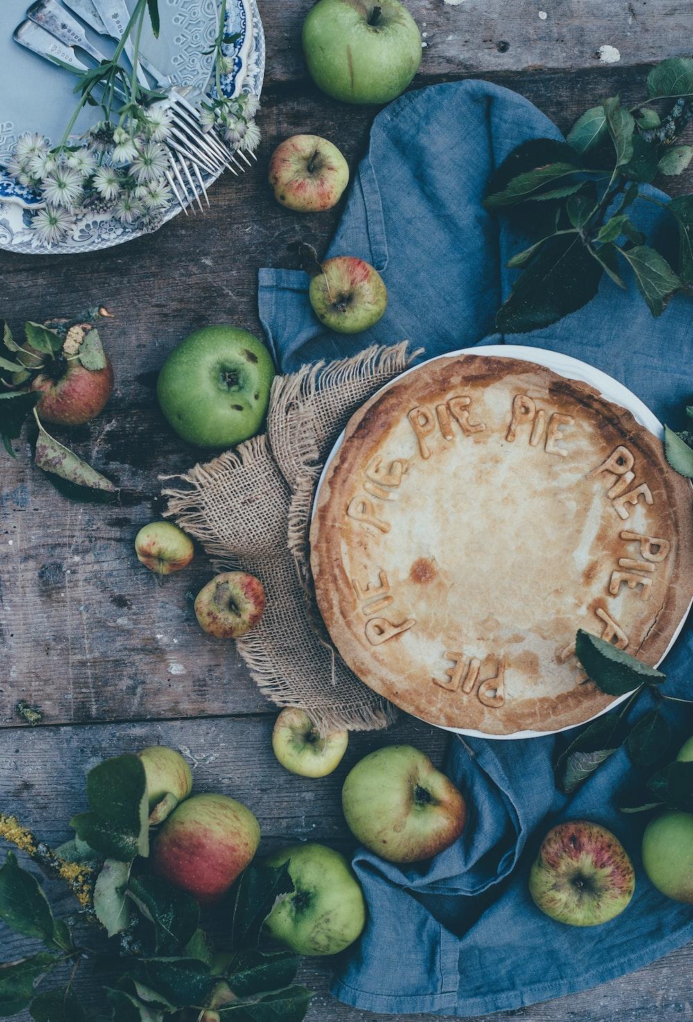 baked pie beside green apples
