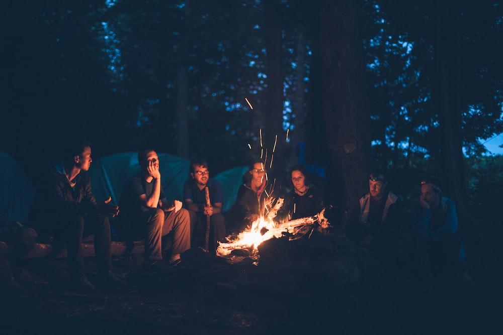 people having a bonfire