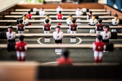 brown foosball table closeup photography