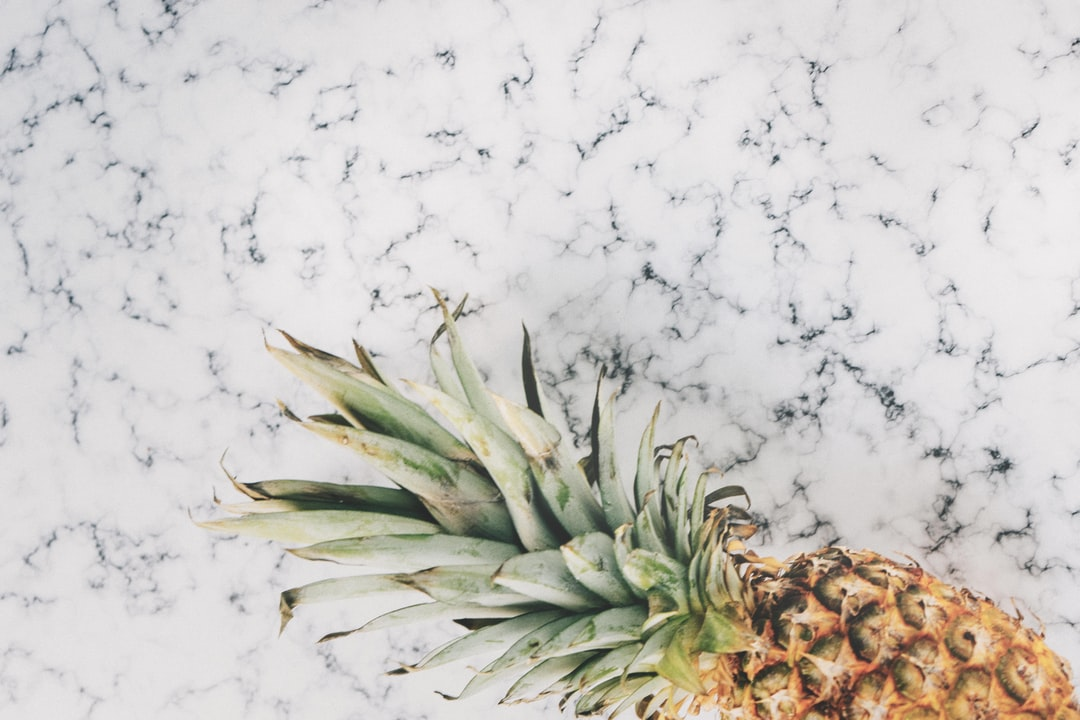 Flatlay of Pineapple on Marble