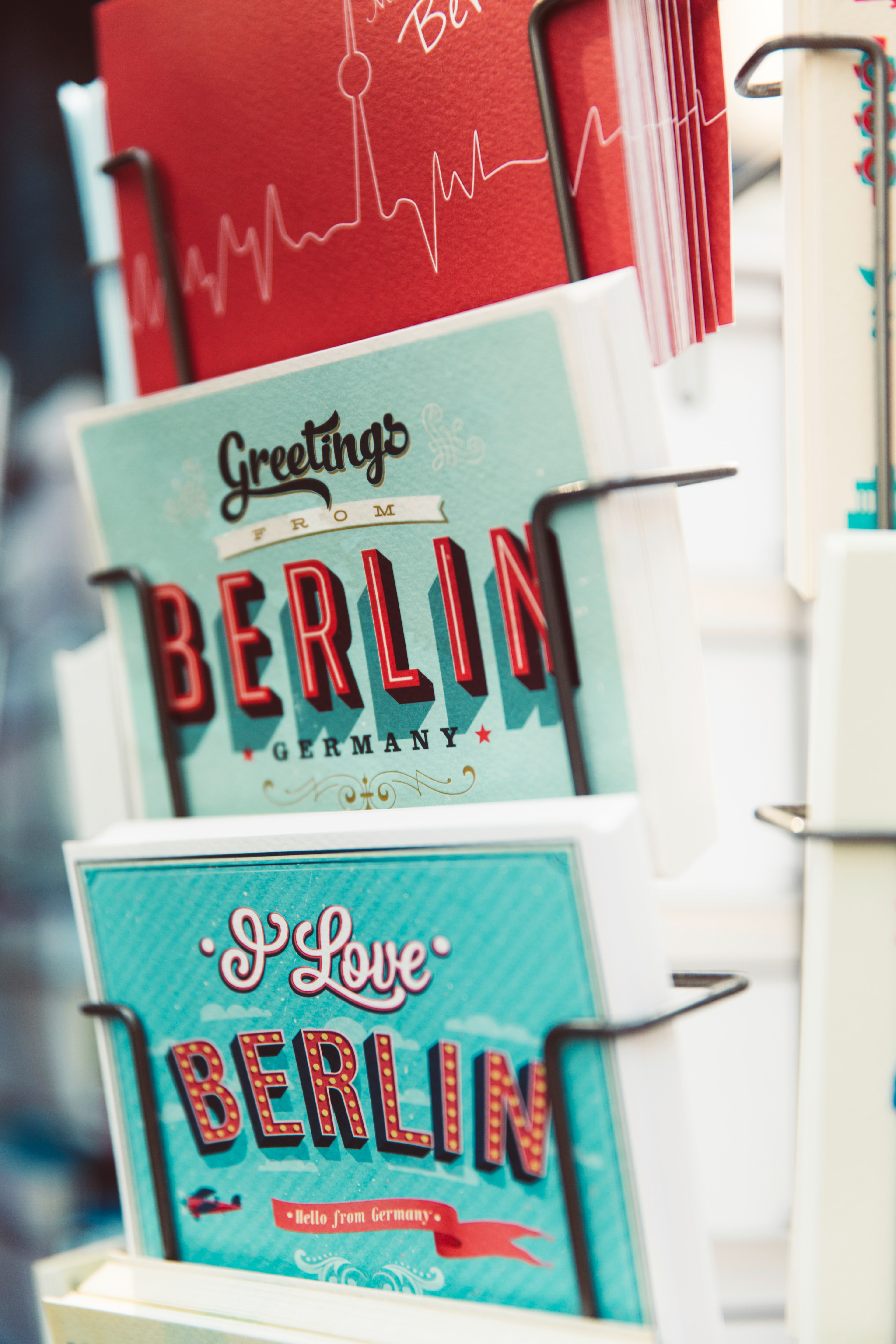 Colorful postcards from Berlin in a stand