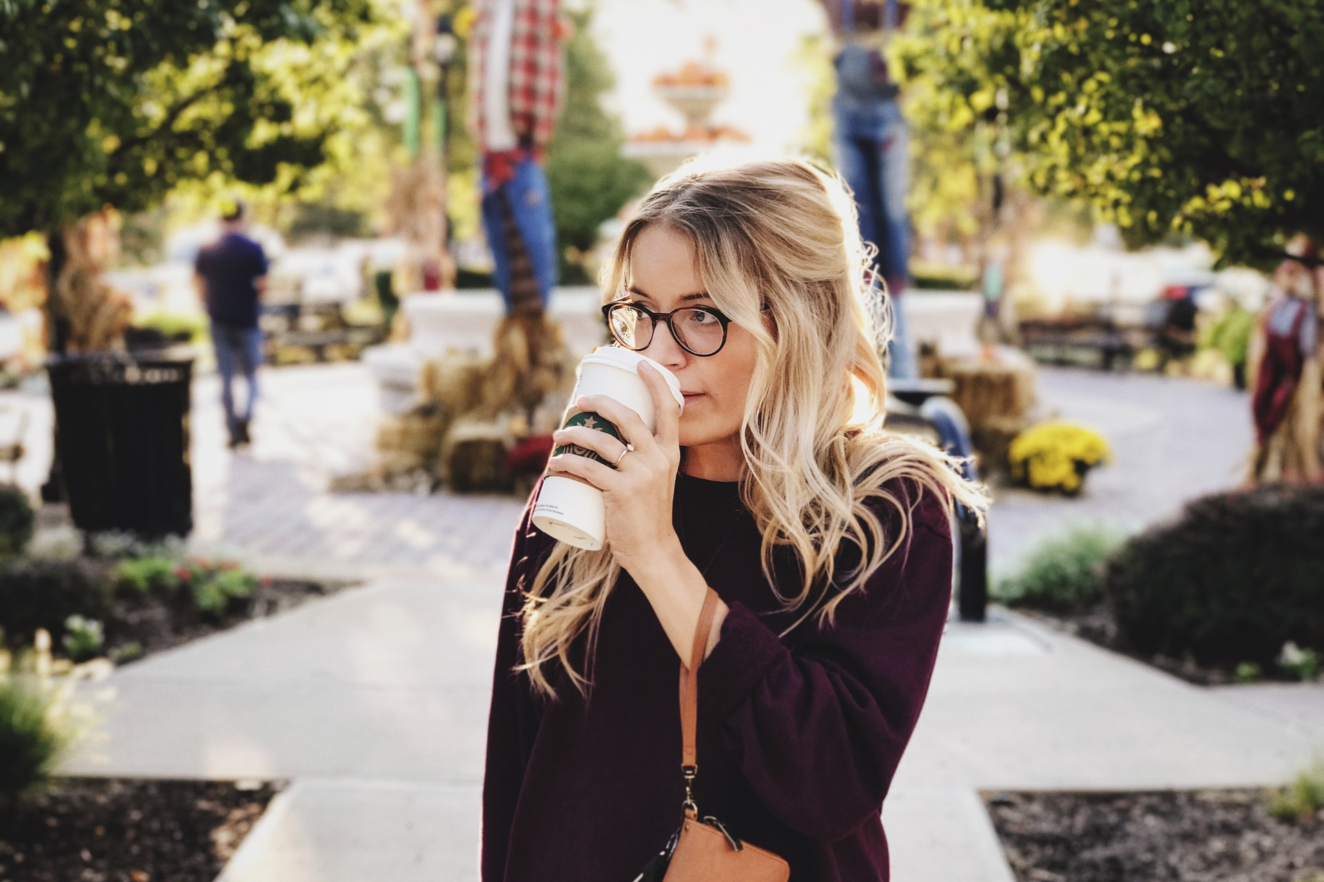 woman drinking on white cup