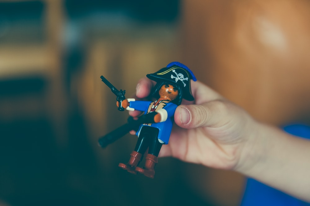 person holding Pirate figure