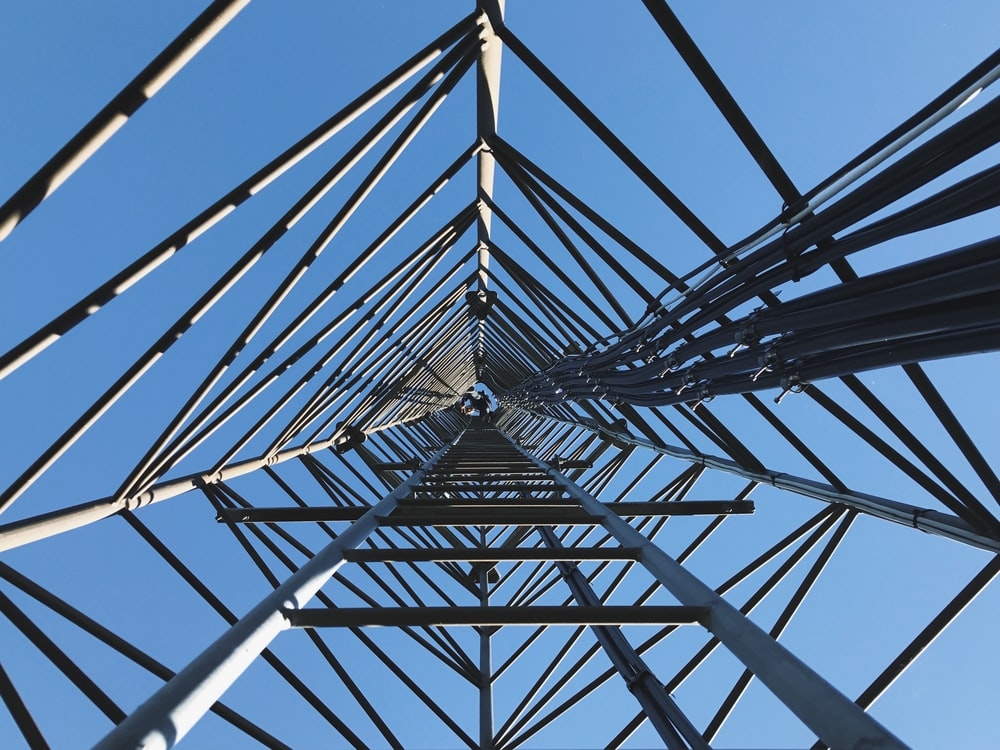 high angle photography of transmission tower