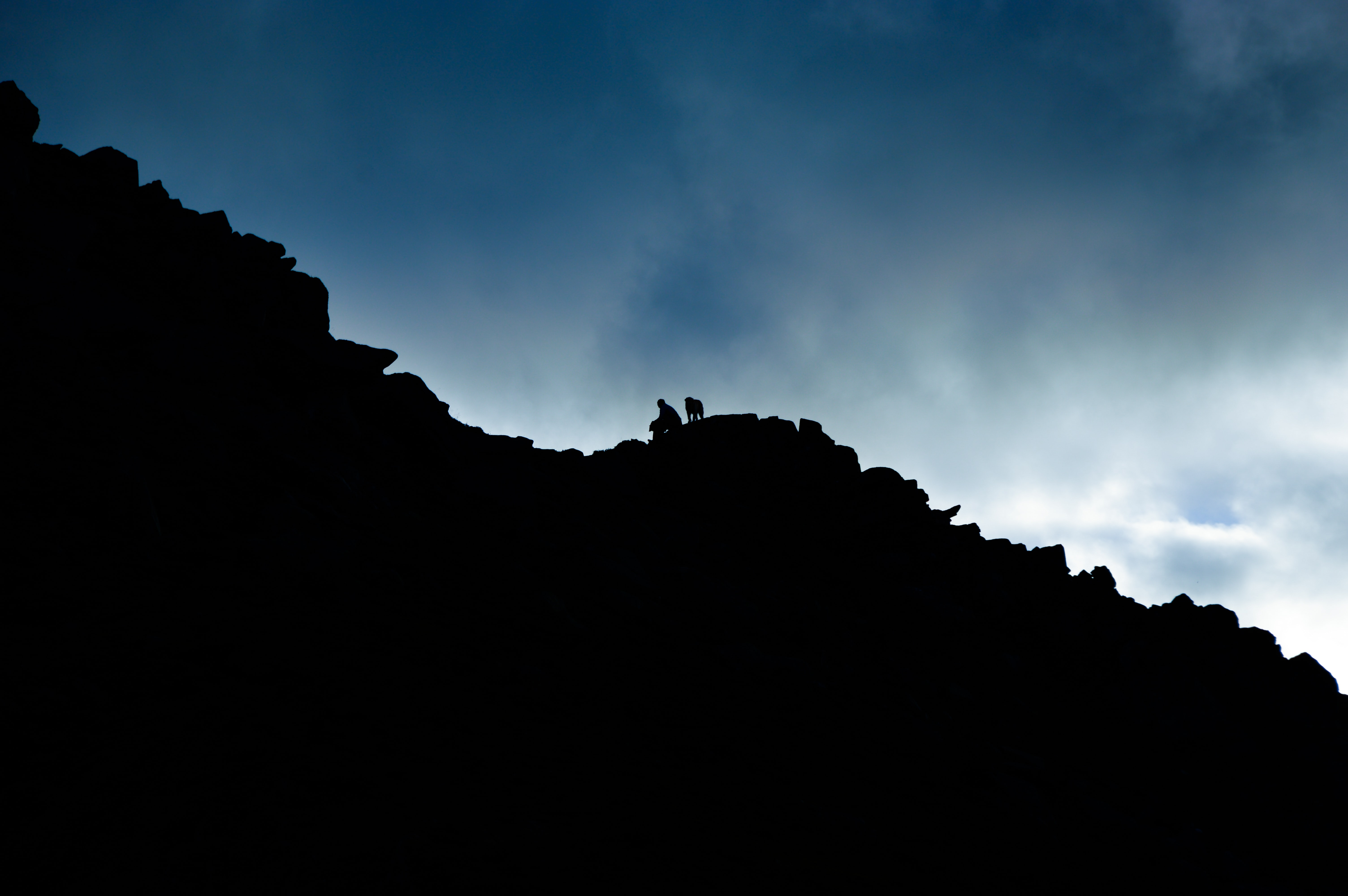 low angle of person on rock cliff