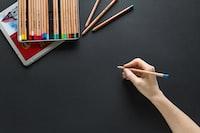 """""""Blue pencil against black paper"""""""