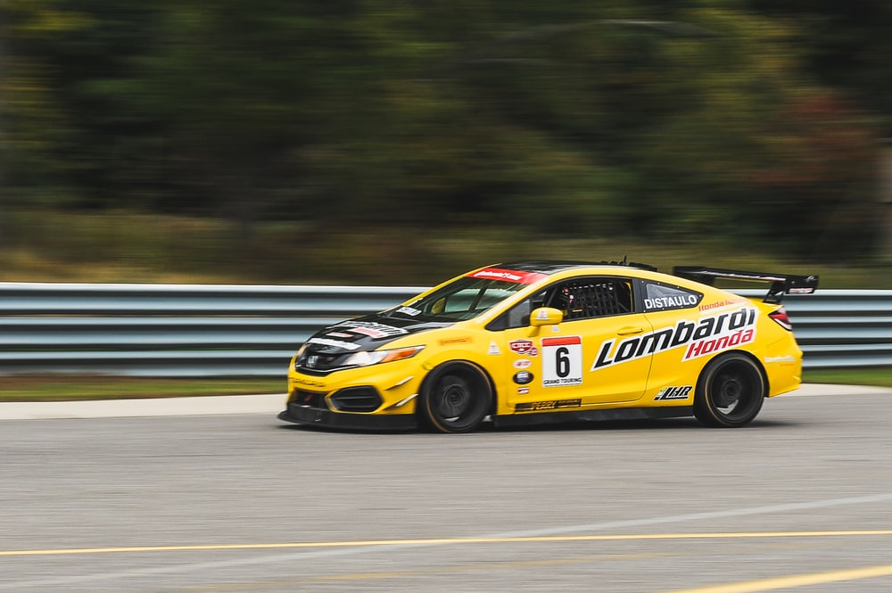 yellow Honda Civic riding on road