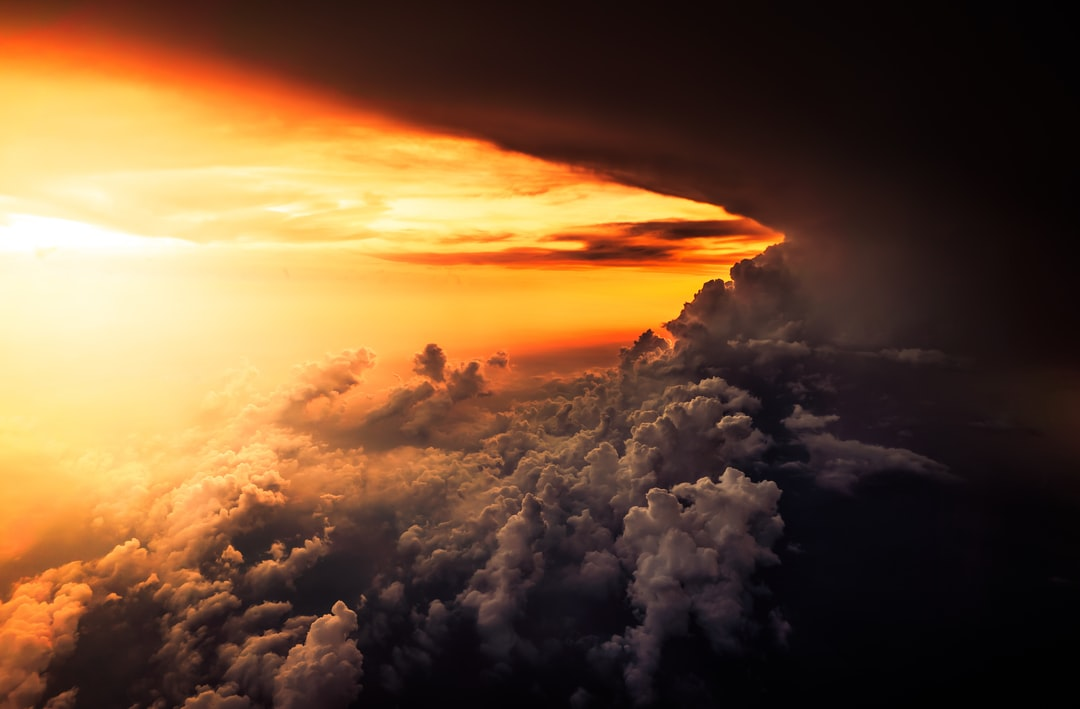 Above the clouds with an orange sky - How the Bible Describes Heaven