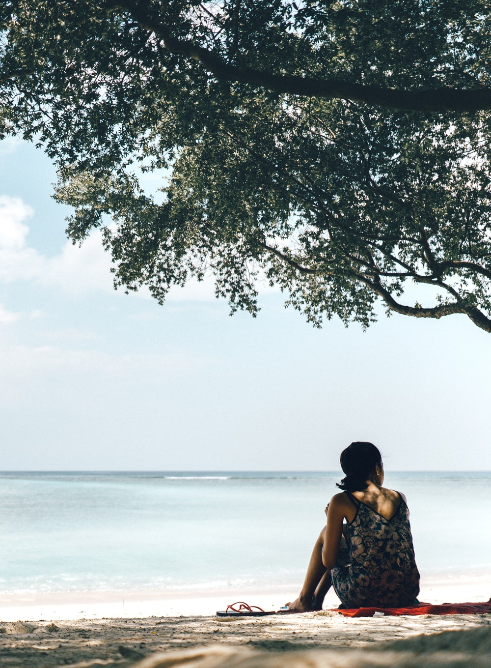 woman beside tree