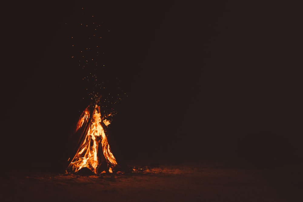 bonfire on brown sand during nighttime