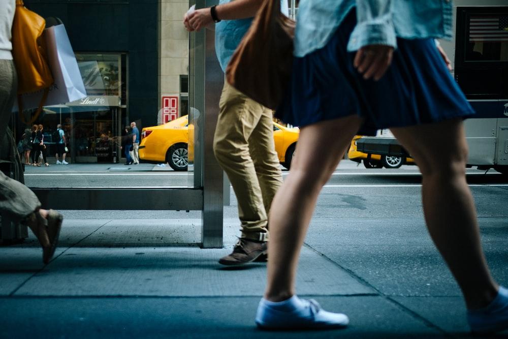 woman walking on road sideways