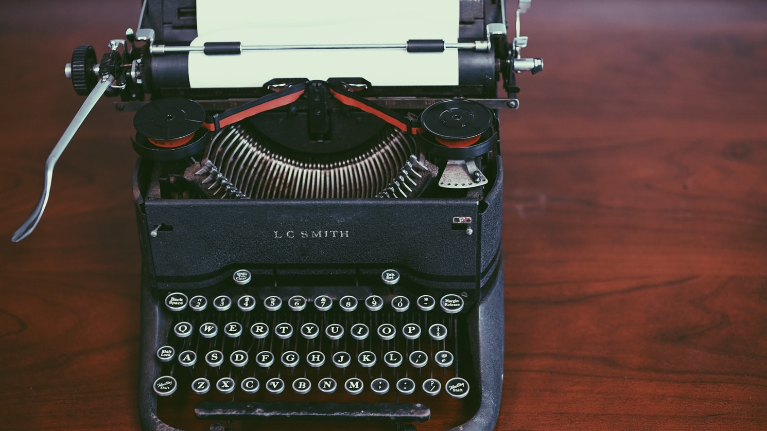 Black typewriter on the wooden table