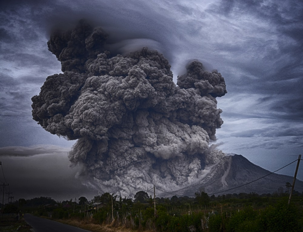 volcano eruption during daytime
