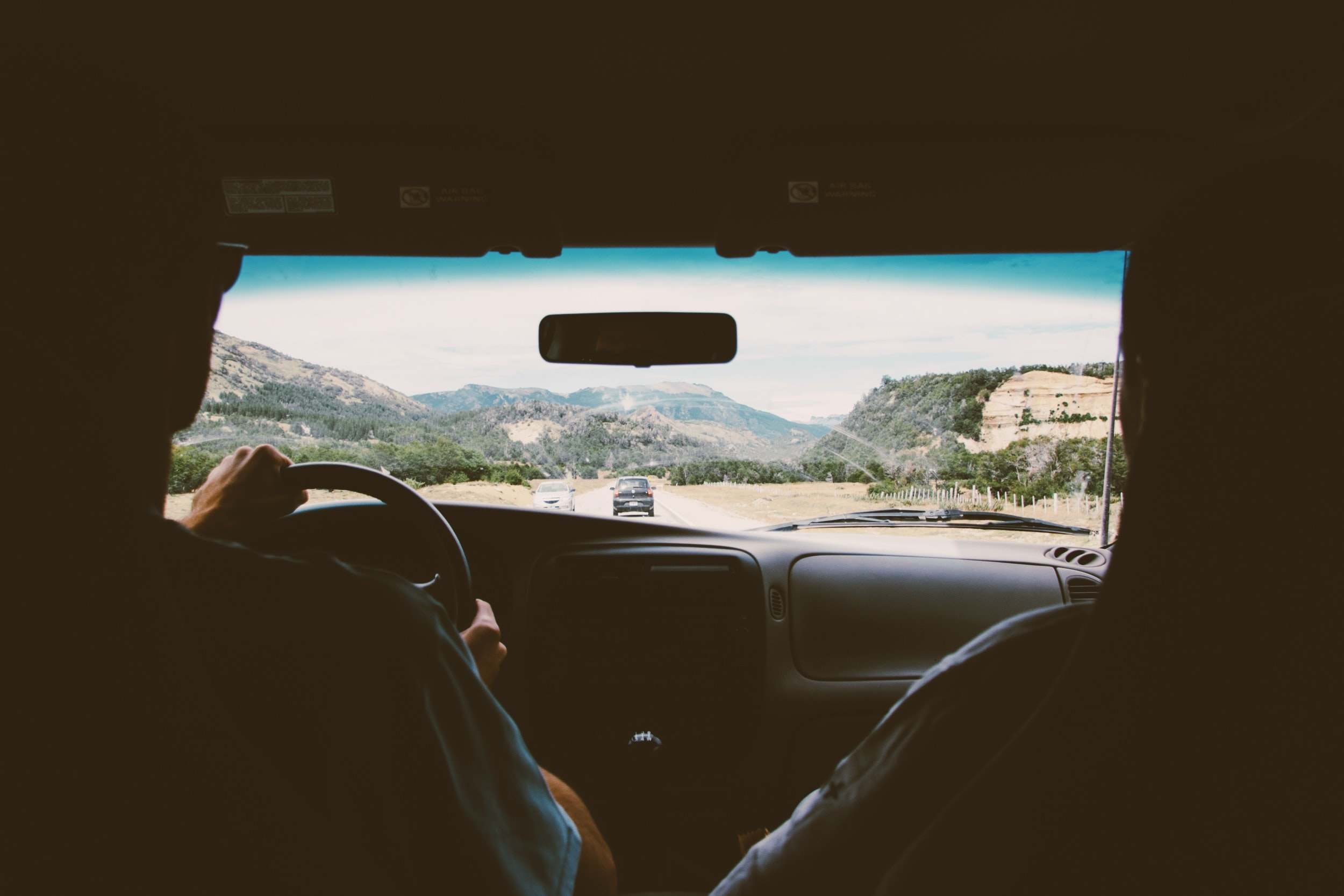POV shot from the backseat during a road trip.