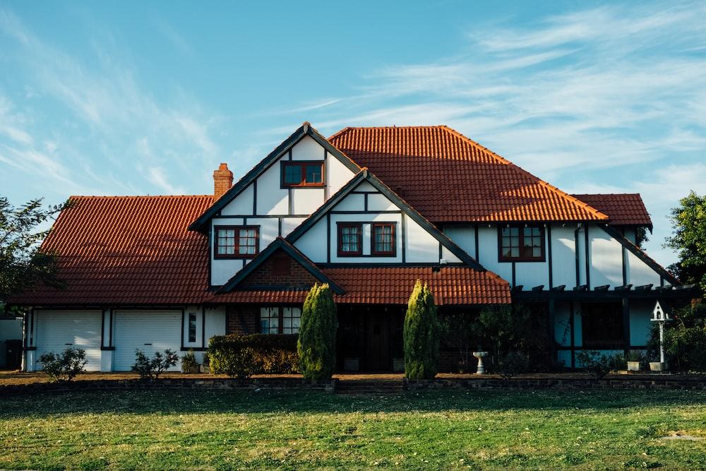 A large suburban house with a garden on a sunny day